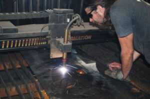 Photo of man creating a wrought iron design with plasma cutting. Wrought Iron Design In Las Vegas
