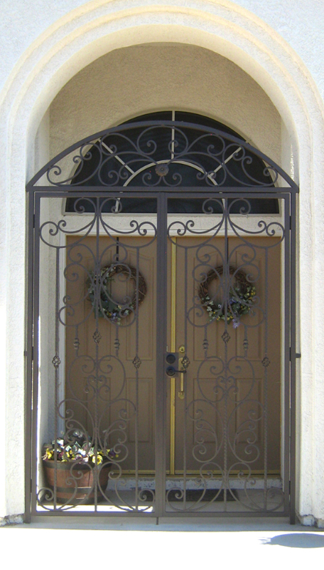 Scrollwork Papillion Entryway Door - Item EW0093 Wrought Iron Design In Las Vegas