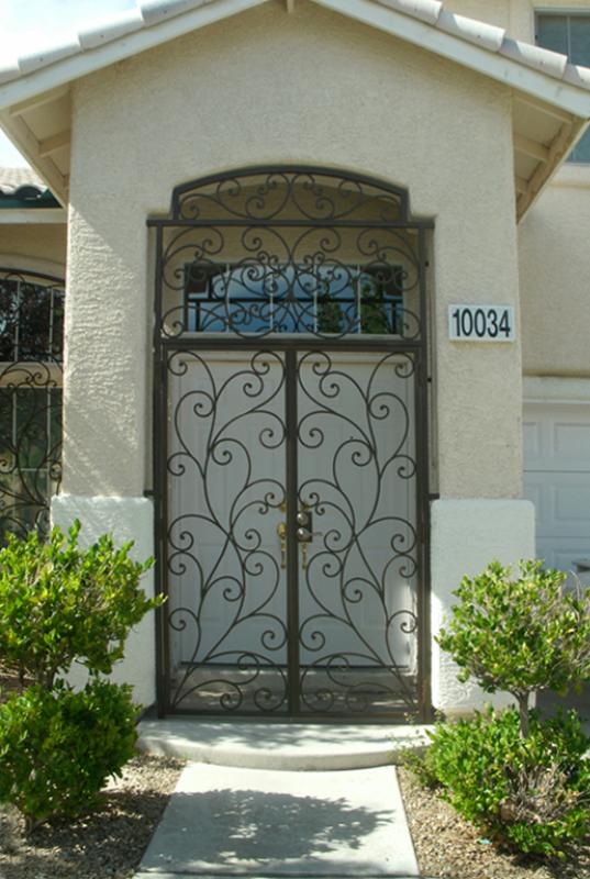 Scrollwork Portini Entryway Door - Item EW0094 Wrought Iron Design In Las Vegas
