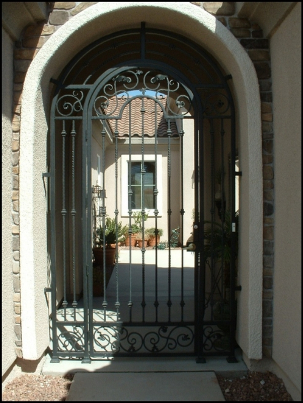 Traditional Custom Archive Arched Entryway Door - Item EW0007 Wrought Iron Design In Las Vegas