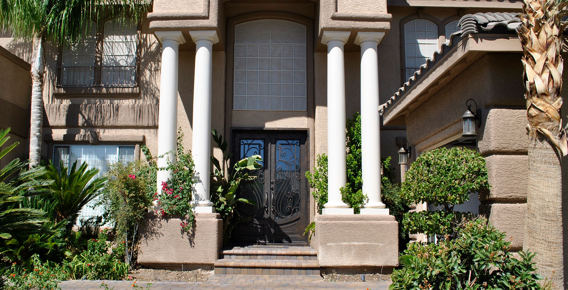 Photo of a home with a custom iron door. Wrought Iron Design In Las Vegas