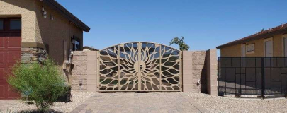 Photo of a tan gate with a sunburst design. Wrought Iron Design In Las Vegas
